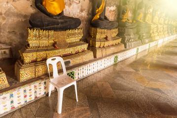 White plastic chair in Wat Suthat Devaravaram temple royal temple at the Giant Swing in Bangkok landmark of Bangkok, Thailand