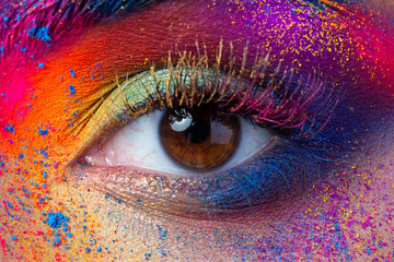 Obraz Close up view of female eye with bright multicolored fashion makeup. Holi indian color festival inspired. Studio macro shot - fototapety do salonu