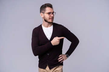 Man presenting something over isolated gray background.