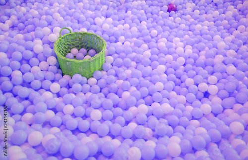 Kids ball pit or ball pool with many colorful balls as