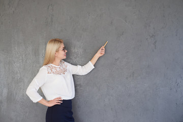 Businesswoman presenting on gray background