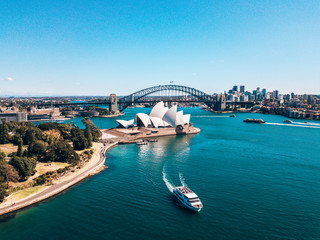 Foto auf Leinwand Blau türkis January 10, 2019. Sydney, Australia. Landscape aerial view of Sydney Opera house near Sydney business center around the harbour.