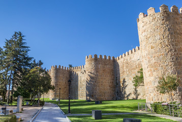 Fototapete - Park and city walls in Avila, Spain