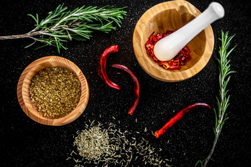 Fresh rosemary, cumin seeds and dried chilli on the table.
