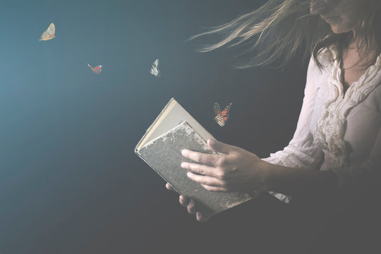 magical butterflies come out of a book read by a woman