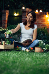 woman choosing seedlings for her garden