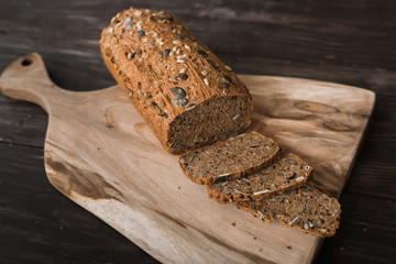 chrono bread sliced on brown wooden background