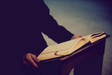 man studying the Quran
