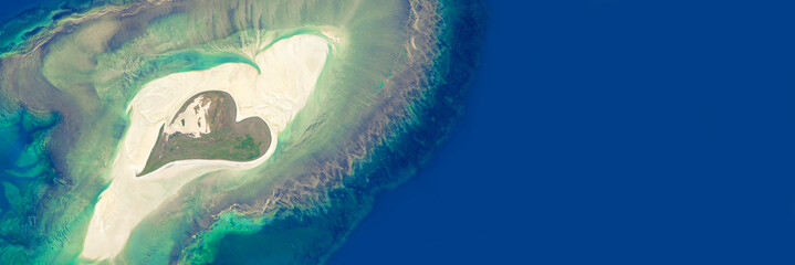 Aerial view of an island in the shape of a heart - Elements of this image are furnished by NASA