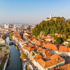 Aerial panoramic view of Ljubljana, capital of Slovenia in warm afternoon sun.