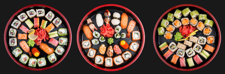Fotobehang Sushi bar Sushi Set nigiri, rolls and sashimi served in traditional Japan black Sushioke round plate. On dark background