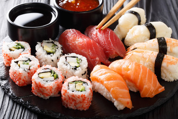 Variety of sushi food. nigiri, maki, uramaki and roll with tuna, salmon and shrimp. Asian food with raw fish and rice. horizontal