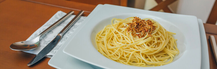Spaghetti with worms dish placed on the table ready to eat
