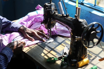 Man working with sewing machine in Kumrokhali, West Bengal, India