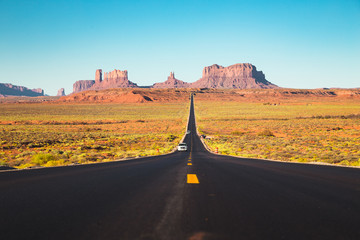 Wall Mural - Straight road in Monument Valley at sunset, USA