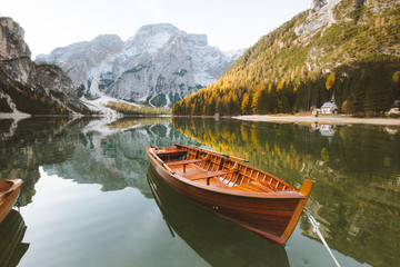 Wooden rowing boat on alpine lake in fall