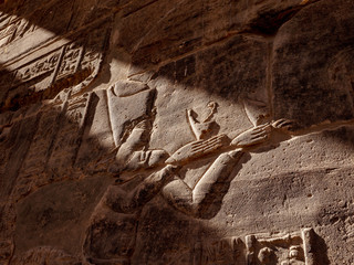 Anciient Egyptian hieroglyphs depicting goddess Isis in Egyptian temple Philae in Aswan