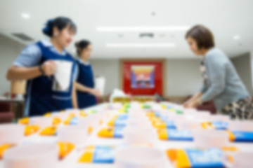 Picture blurred for background abstract and can be illustration to article of catering service. Employees are served coffee break between meeting and snack on dish