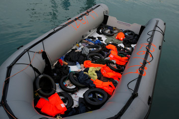 A dinghy with floats and life-vests of migrants is seen after they arrived on a rescue boat at dawn at the port of Malaga