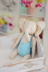 handmade toys elephant, decor in a children's photo studio, pastel colors