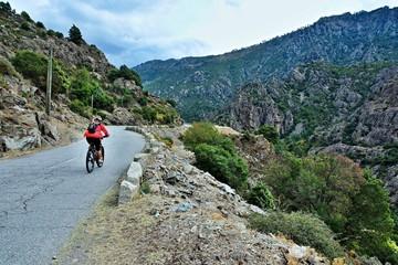 Corsica-cyclist in the canyon river Golo