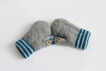 3345cef80a44 Pair of grey knitted mittens on white background