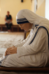 The statue of Mother Teresa in the chapel of the Mother House, Kolkata, India. The statue was made in the pose in which the Mother prayed.
