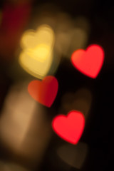 Red and golden heart bokeh black background photo