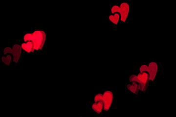 Red heart bokeh black background photo
