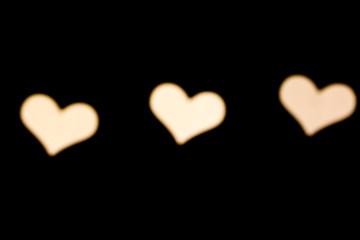 White heart bokeh black background photo
