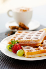 breakfast waffles with syrup strawberry banana coffee and cookies