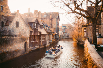 Wall Murals Bridges Historic city of Brugge with boat on canal, Flanders, Belgium