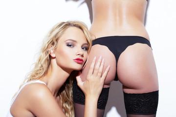 Sexy blonde woman touching lesbian girlfreinds ass
