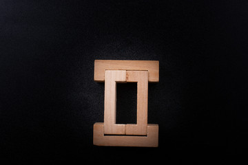 Roman numeral two sign icon made of wood