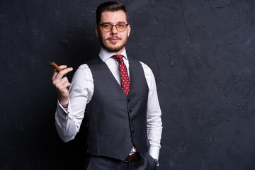 Portrait of an attractive business man with a cigar.