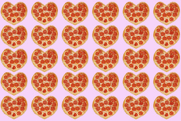 many pizza in shape of heart concept valentine's day isolated on pink. background for 14 february