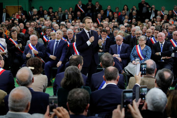"""French President Emmanuel Macron delivers a speech during a meeting with mayors from rural Normandy as part of the launching of the """"Great National Debate"""" in Grand Bourgtheroulde"""