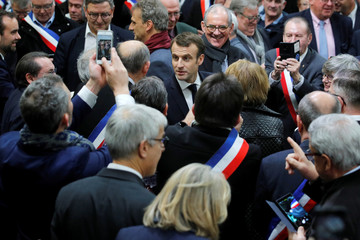 """French President Emmanuel Macron arrives to attend a meeting with mayors from rural Normandy as part of the launching of the """"Great National Debate"""" in Grand Bourgtheroulde"""