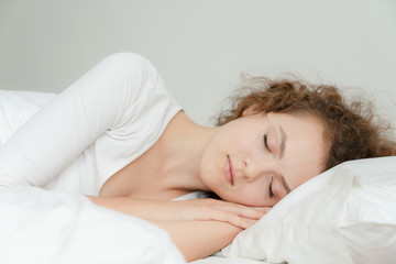 Beautiful young woman happy to sleeping and deep sleep in her bed