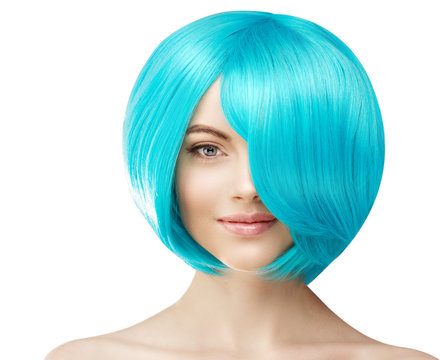 A girl with blue hair. Model with colored haircut. Woman with voluminous hairstyle