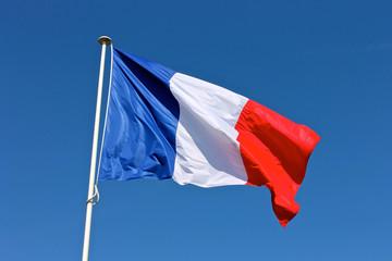 Flag of France waving over a blue sky Fotobehang