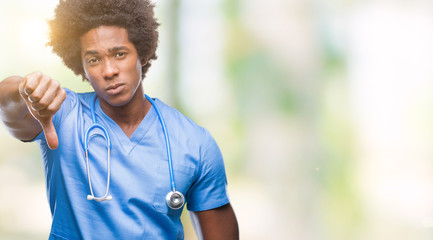 Afro american surgeon doctor man over isolated background looking unhappy and angry showing rejection and negative with thumbs down gesture. Bad expression.