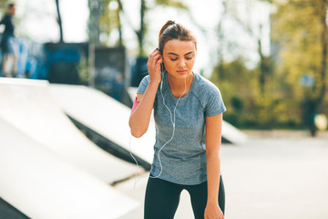 Young woman having exercise in the park