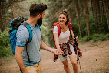 Young couple enjoying hiking in nature