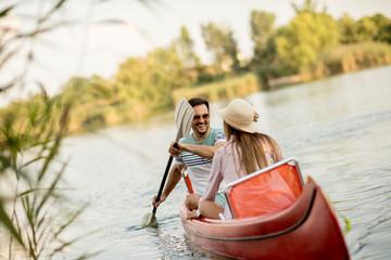 Loving couple rowing on the lake
