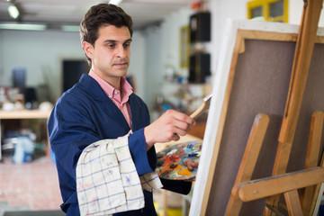 Male artist drawing in studio