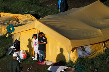 Venezuelan migrant children stand in front of their tent inside a temporary humanitarian camp that is closed by the government, in Bogota