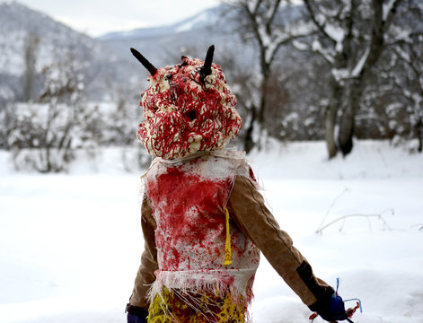 unrecognizable man wearing  mask on  at  Vevcani Carnival, in southwestern Macedonia