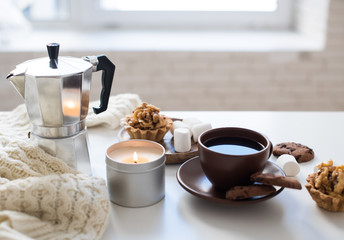 Cozy home breakfast with coffee and cookies on table