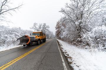 yellow dumptruck snowplow